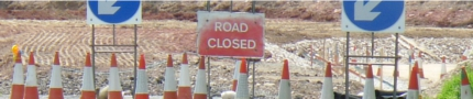 Road closure signs and cones